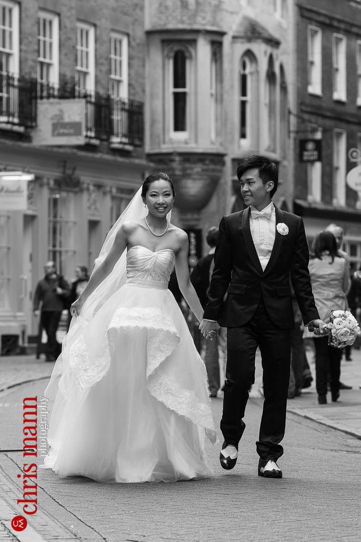 Cambridge pre-wedding shoot couple walking through streets