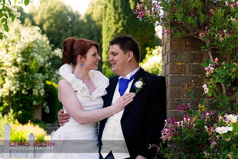 Kimberley & Richard at Bentley - bride and groom in garden