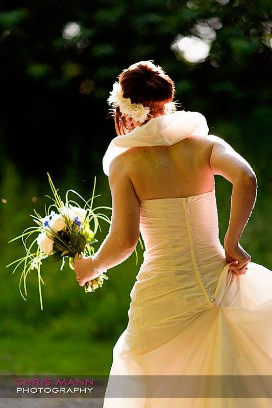 Kimberley & Richard at Bentley - bride backlit by sunshine