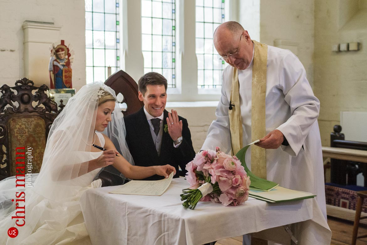 groom shows off wedding ring after wedding at St George's Church Campden Hil London