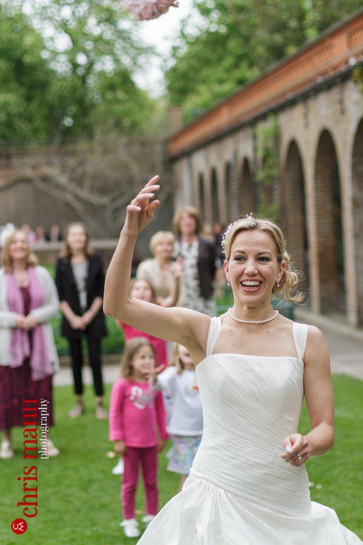 Orangery Holland Park Wedding bride tosses bouquet to guests