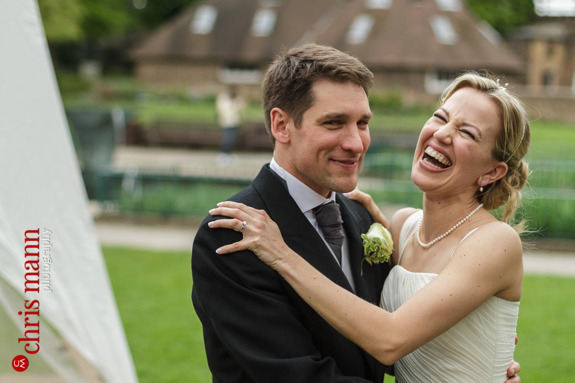 Orangery Holland Park Wedding laughing bride and happy groom