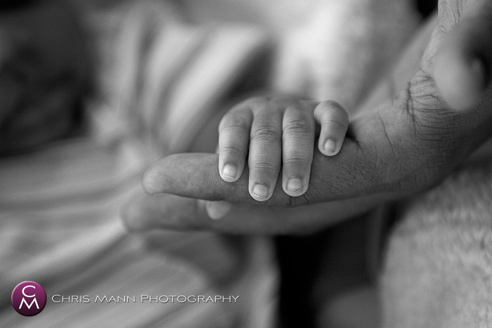 father holding his baby's hand