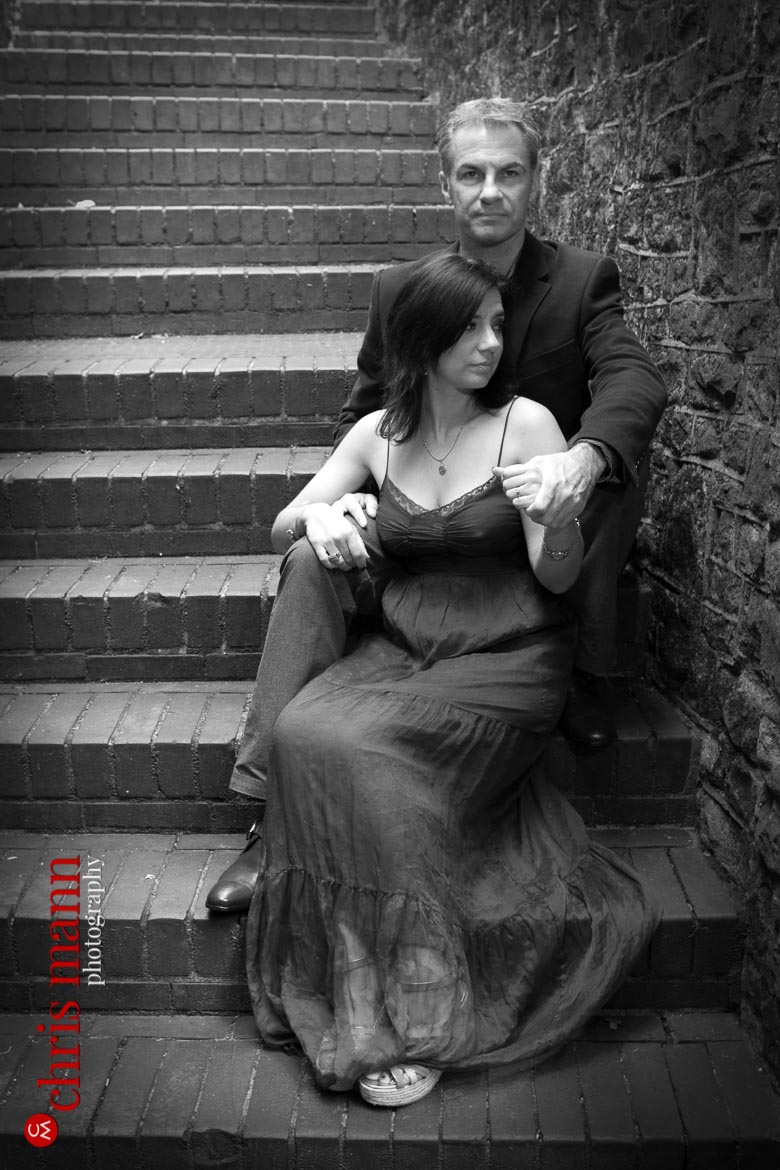 Engagement shoot Guildford Castle couple portrait sitting on steps black and white