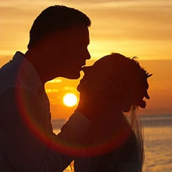 Destination wedding planning tips - Couple sunset silhouette