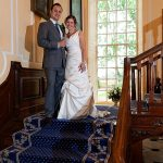 Gosfield Hall Essex bride and groom on staircase