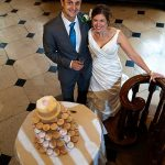 Gosfield Hall Essex bride and groom with wedding cake