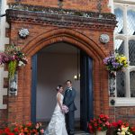 Gosfield Hall Essex bride and groom at entrance