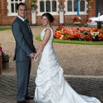 Gosfield Hall Essex bride and groom in archway