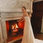 bride by fireplace Thonrton Manor