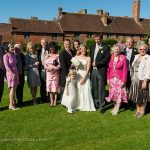 walled garden at cowdray wedding group photo