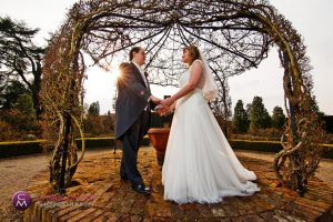 bride and groom in the gazebo at Loseley Park