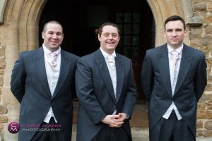 groom with groomsmen outside church