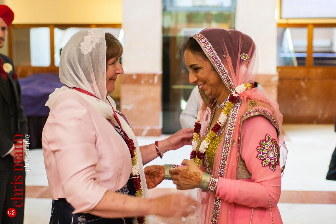 mothers of bride and groom greet each other Sikh wedding