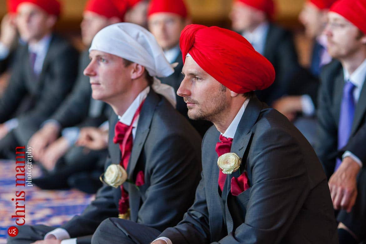 Groom and best man at Sikh wedding ceremony in gurdwara