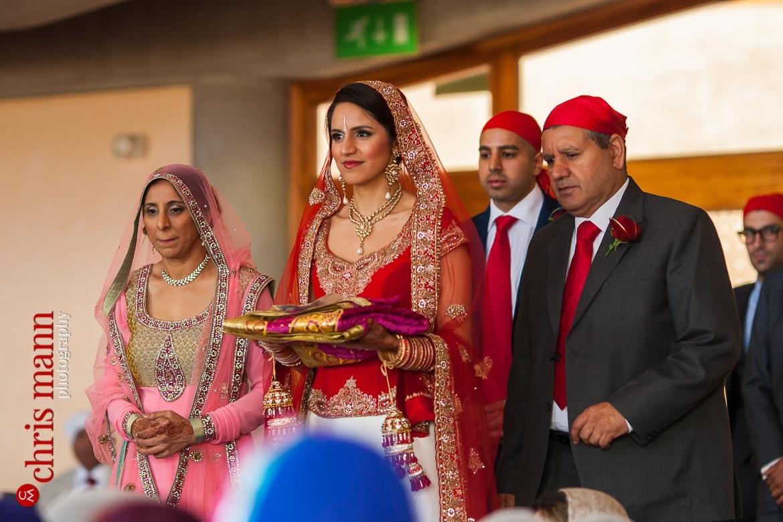 Bride arrives at Sikh wedding ceremony in gurdwara