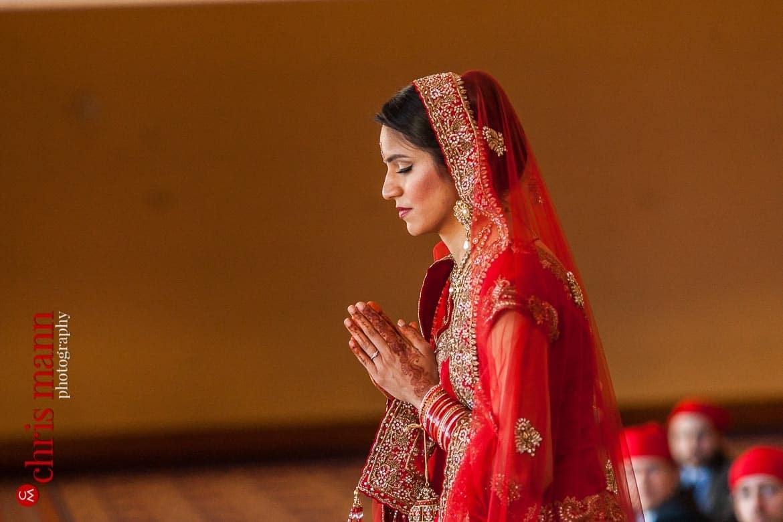 bride prays at Sikh wedding ceremony