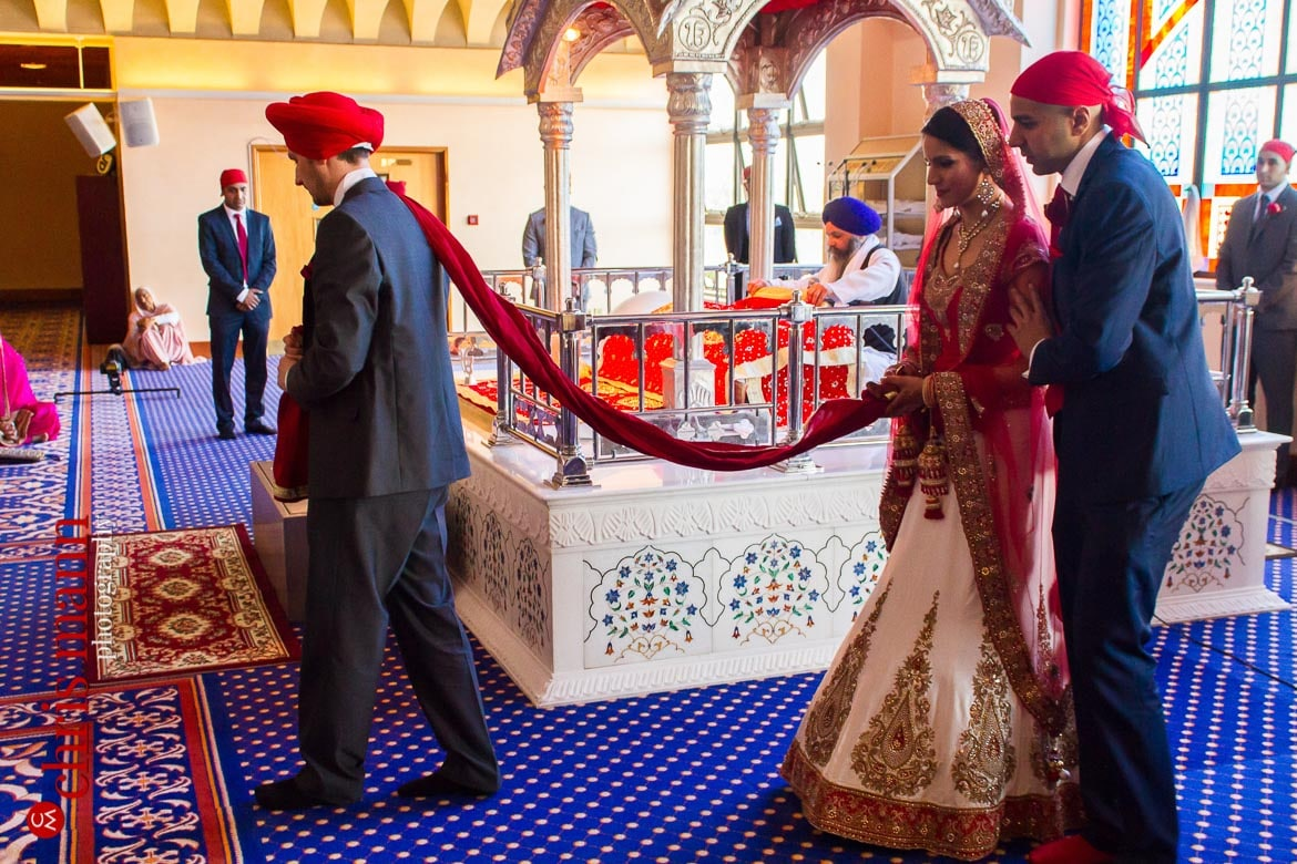 Bride and groom in procession at Sikh wedding ceremony