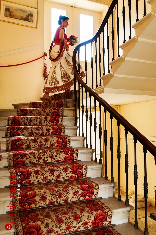 bride ascends staircase at Syon House London wedding