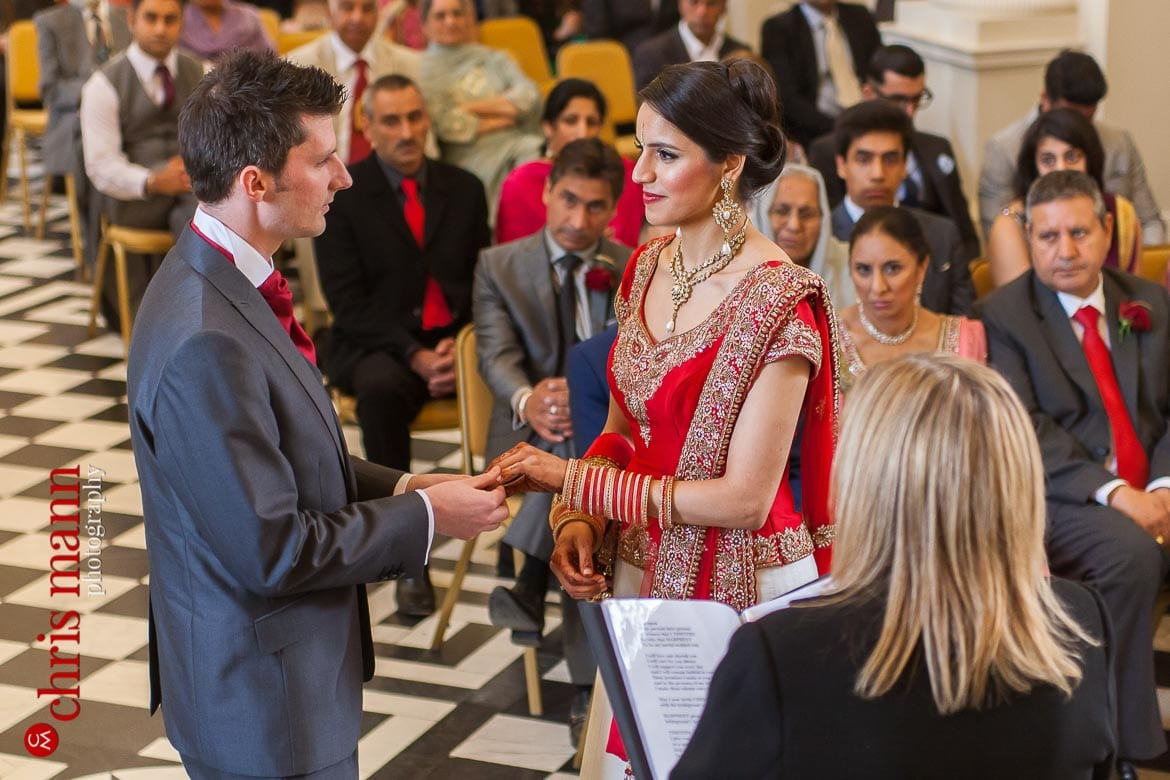 Syon Park wedding bride and groom exchange rings Syon House civil ceremony