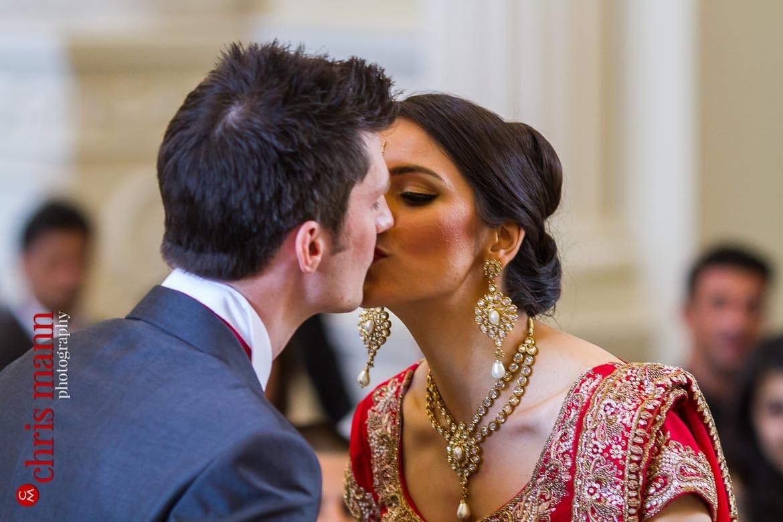 bride and groom kiss Syon Park civil ceremony