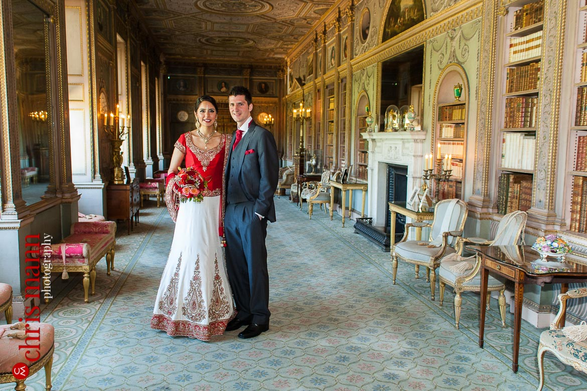 bride and groom pose in library at Syon House London