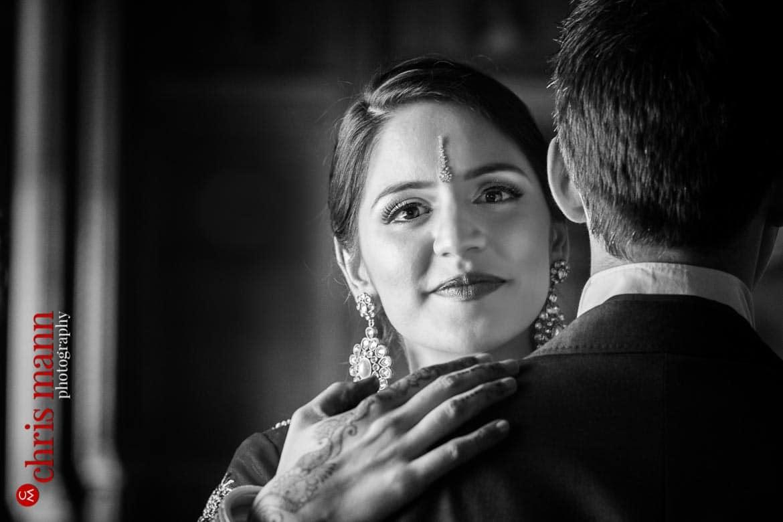 bride looks at camera over groom's shoulder wedding Syon Park London