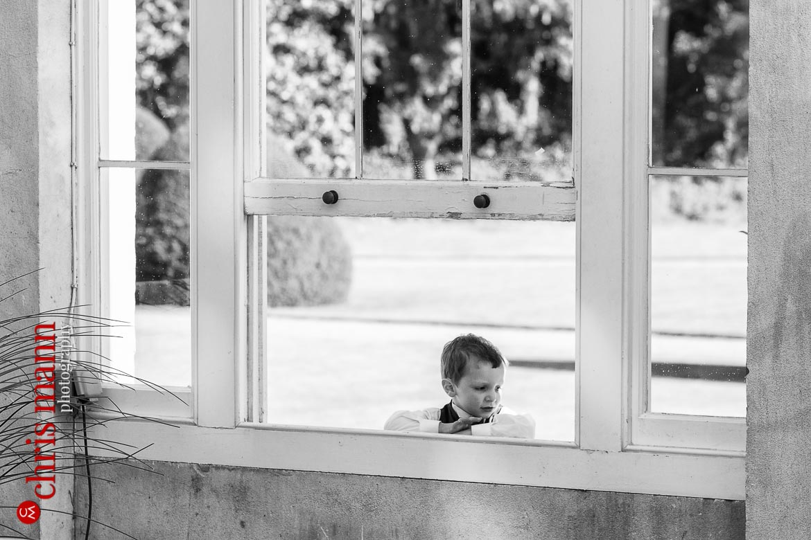 young guest peeps through window at reception Syon Park Great Conservatory