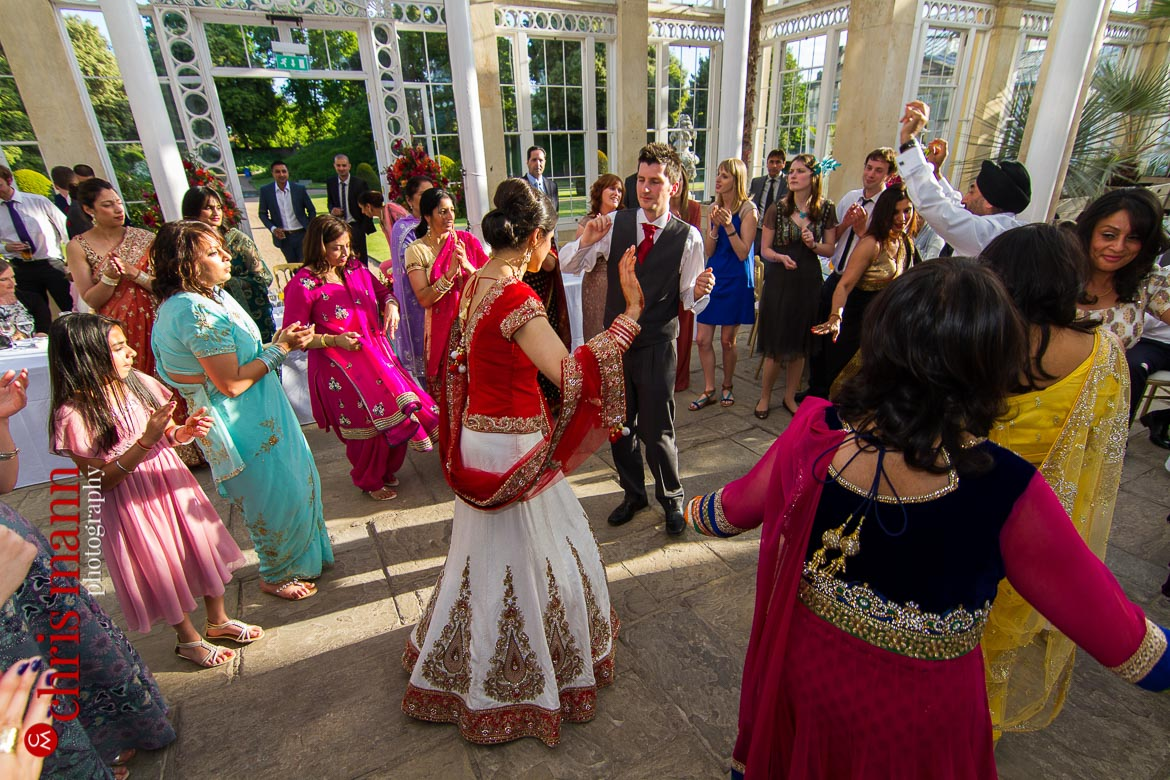 guests dancing at reception Syon Park Great Conservatory
