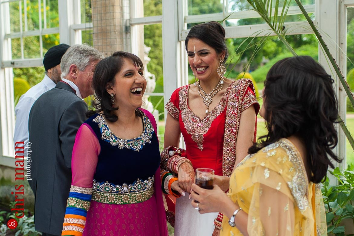 happy bride with relatives at reception Syon Park Great Conservatory