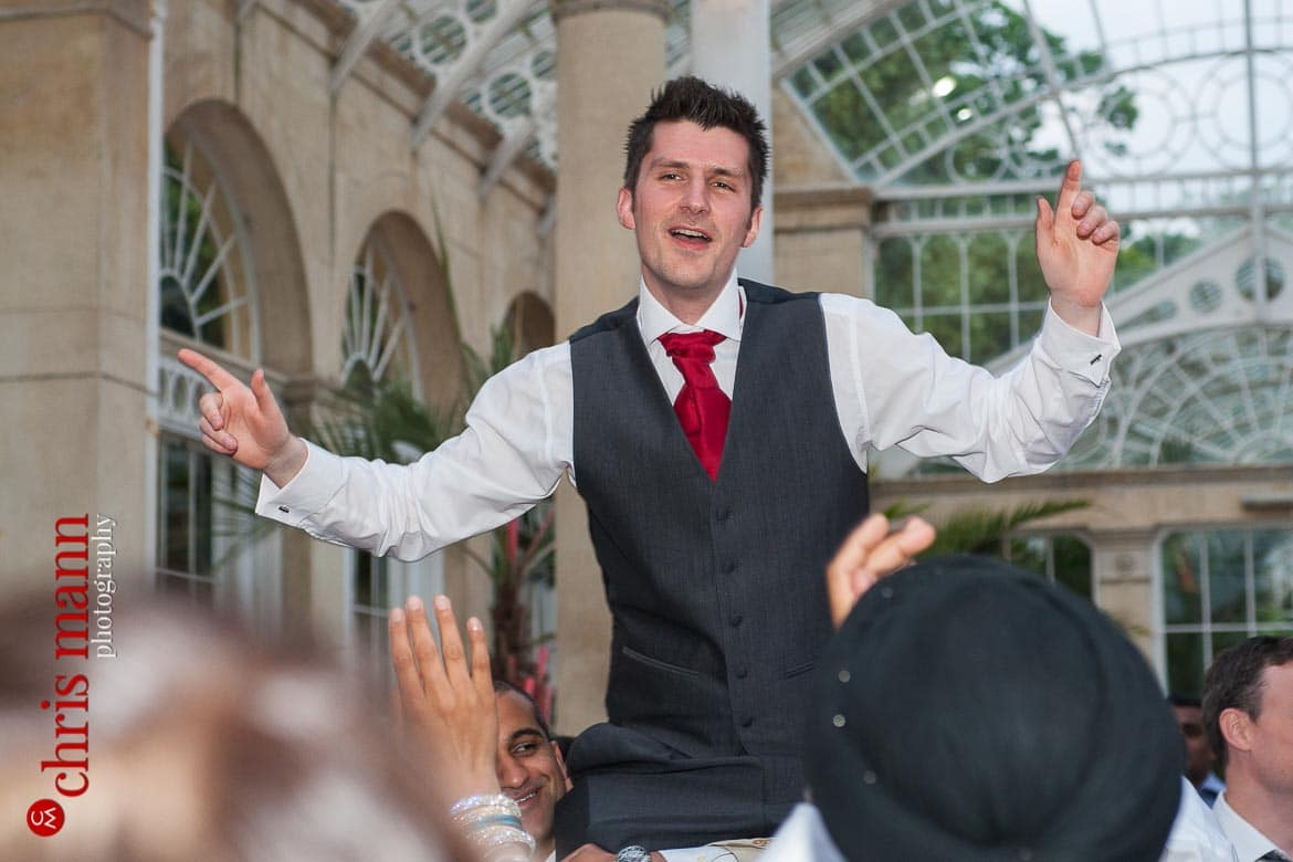 groom dancing at reception Syon Park Great Conservatory