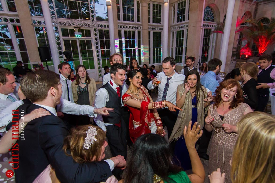 bride groom and guests dancing at reception Syon Park Great Conservatory