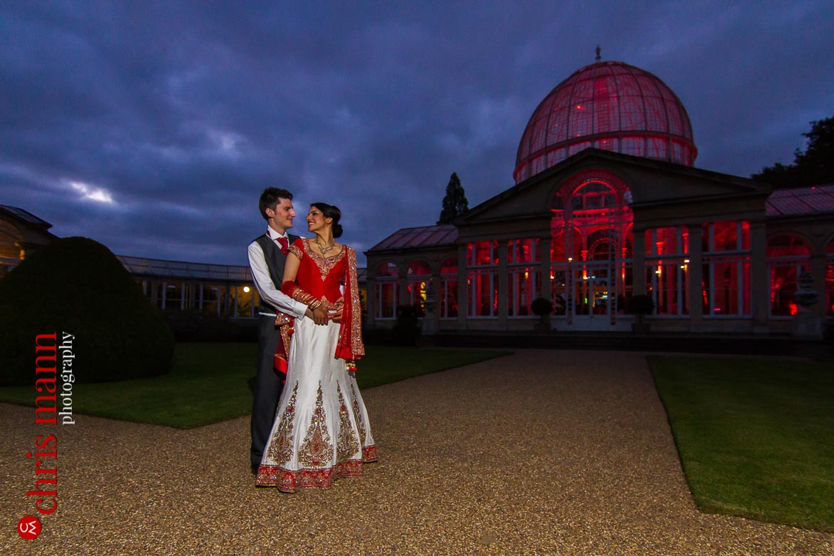 bride and groom outside at dusk Syon Park Great Conservatory