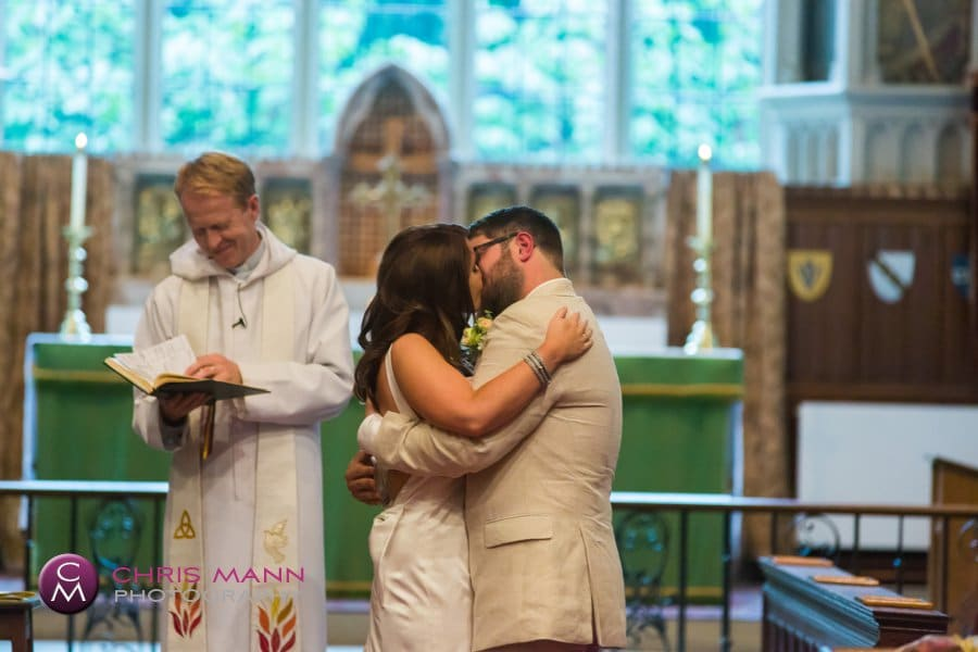 bride and groom first kiss wedding st nicolas cranleigh surrey