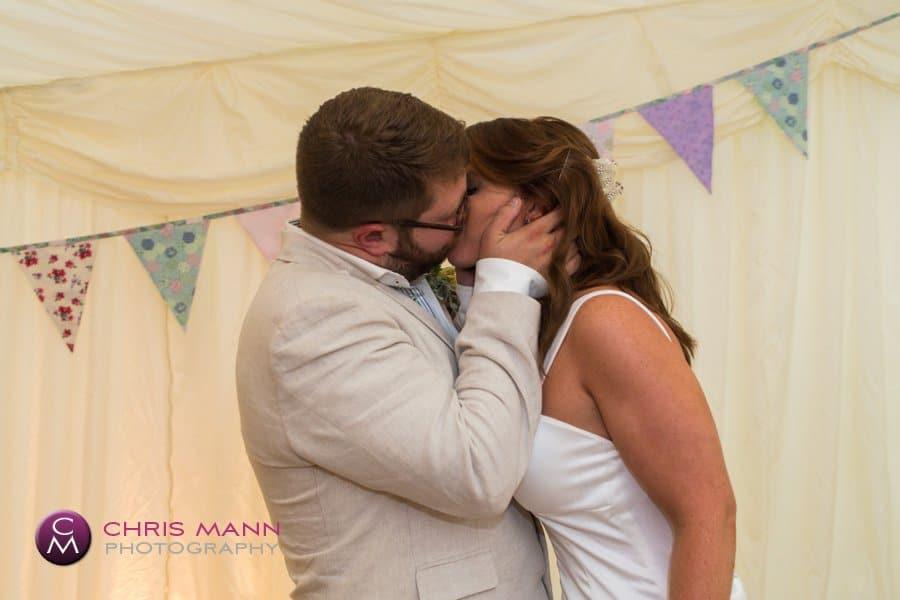 bride and groom kiss wedding reception marquee surrey