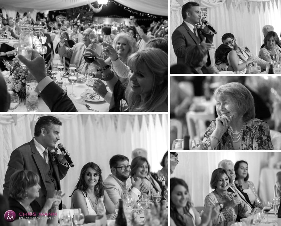 speeches and clapping guests maquee wedding reception surrey