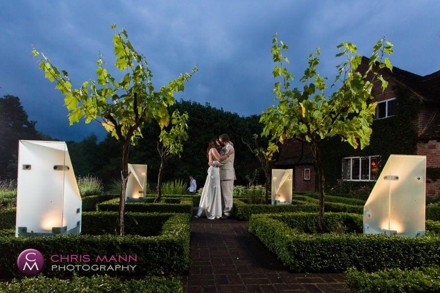 bride and groom in vines surrey