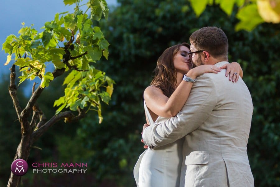 bride and groom embrace among vines evening surrey
