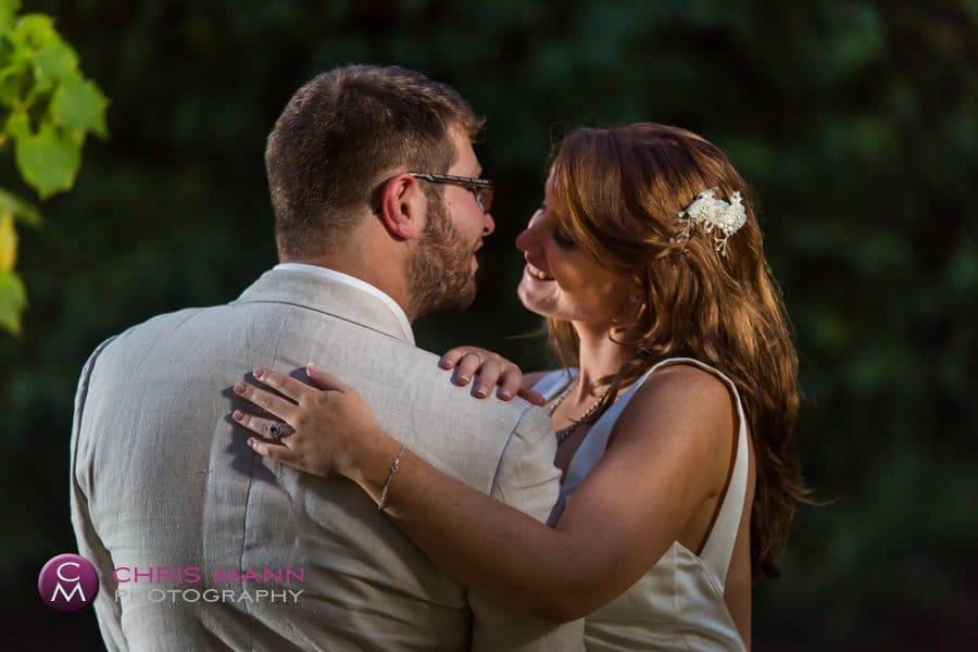 hugging bride and groom vines surrey