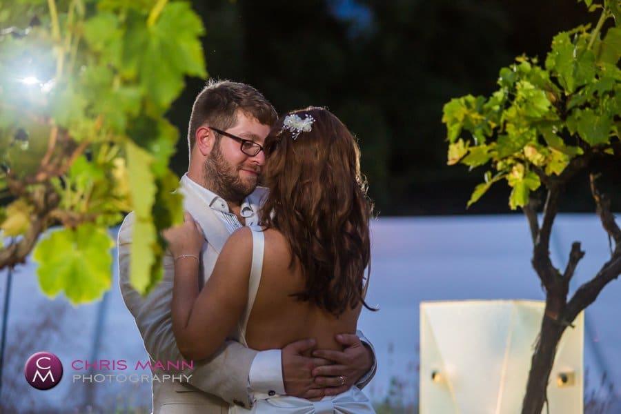 embracing bride and groom vines evening reception surrey