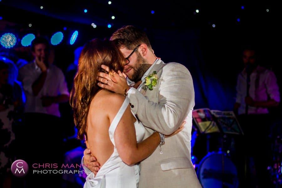 bride and groom kiss dancefloor wedding reception