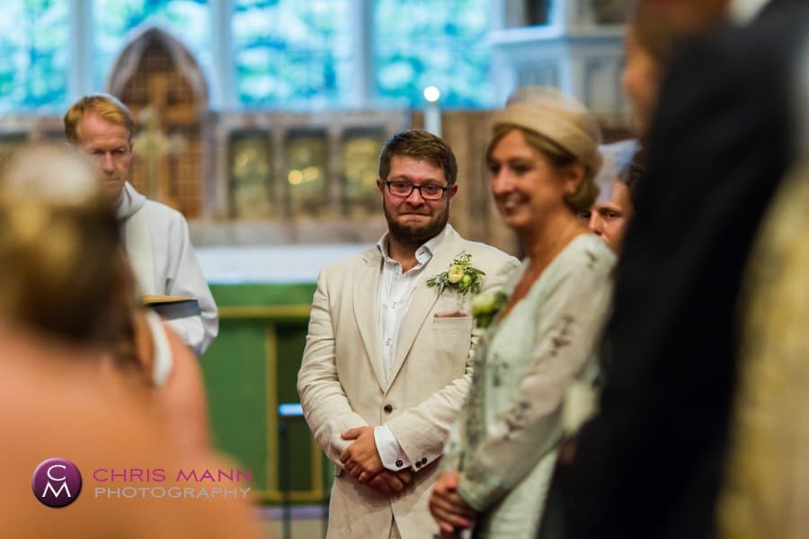 groom sees his bride coming down the aisle