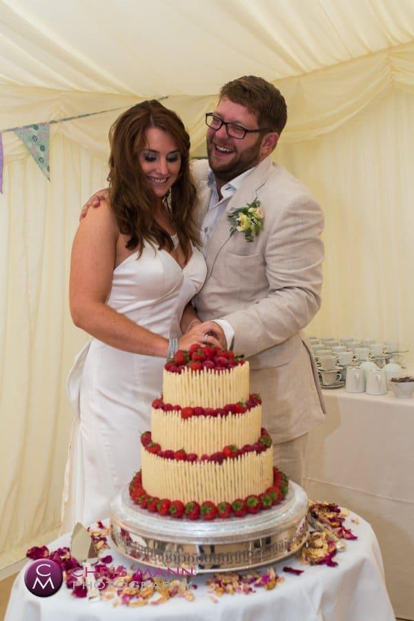 cutting the cake Surrey marquee wedding