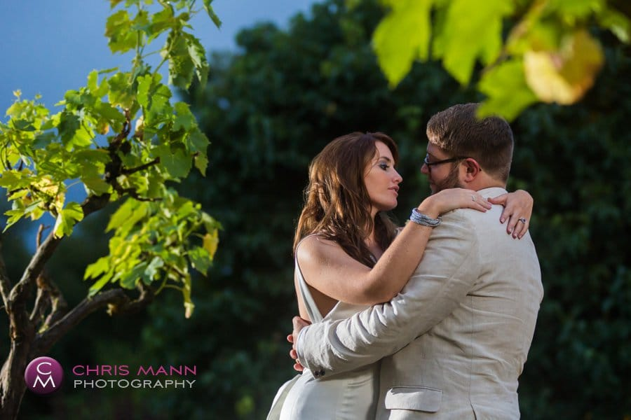 bride and groom night time portrait with vines