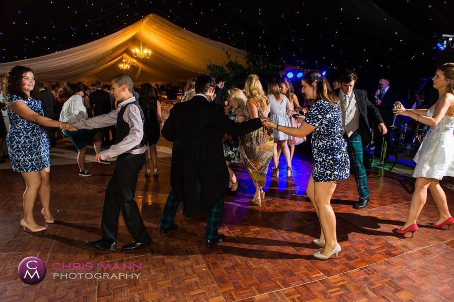 guests dance in the marquee Surrey wedding