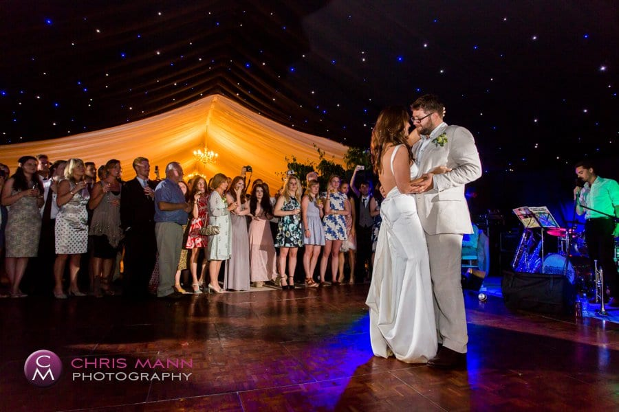 bride and groom first dance marquee wedding reception