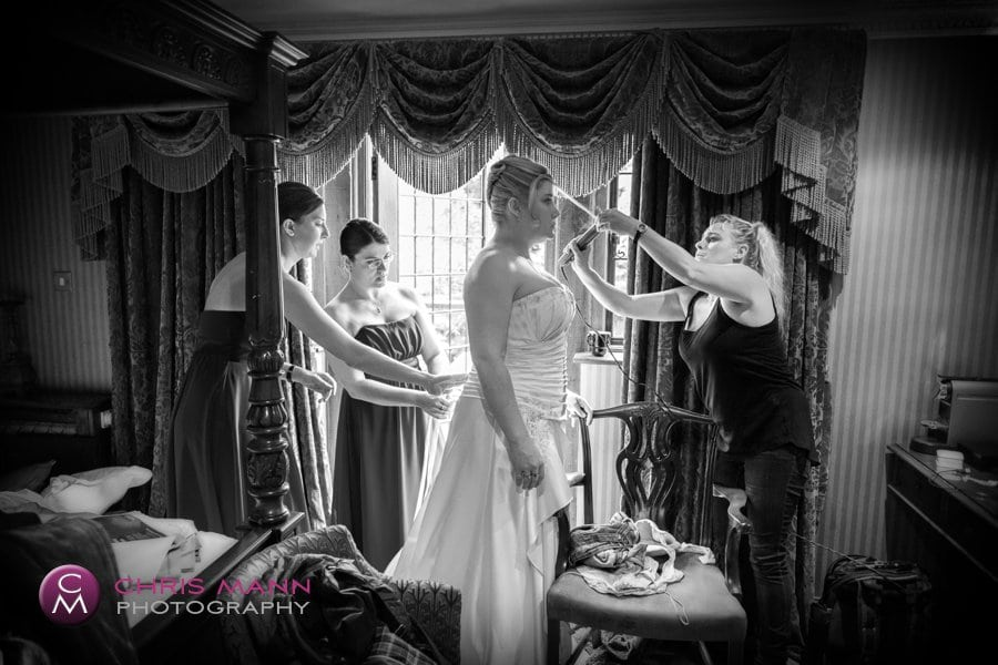 bride and bridesmaids final preparations