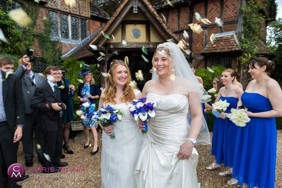 two brides civil partnership confetti toss langshott manor wedding