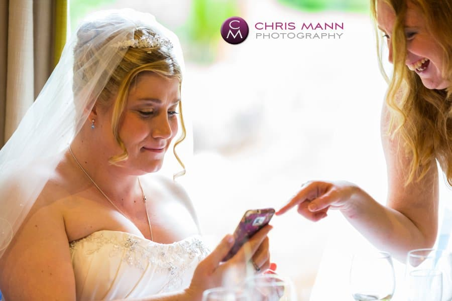 bride checks cellphone