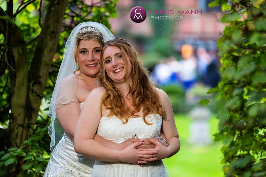 two brides embrace civil partnership langshott manor gardens